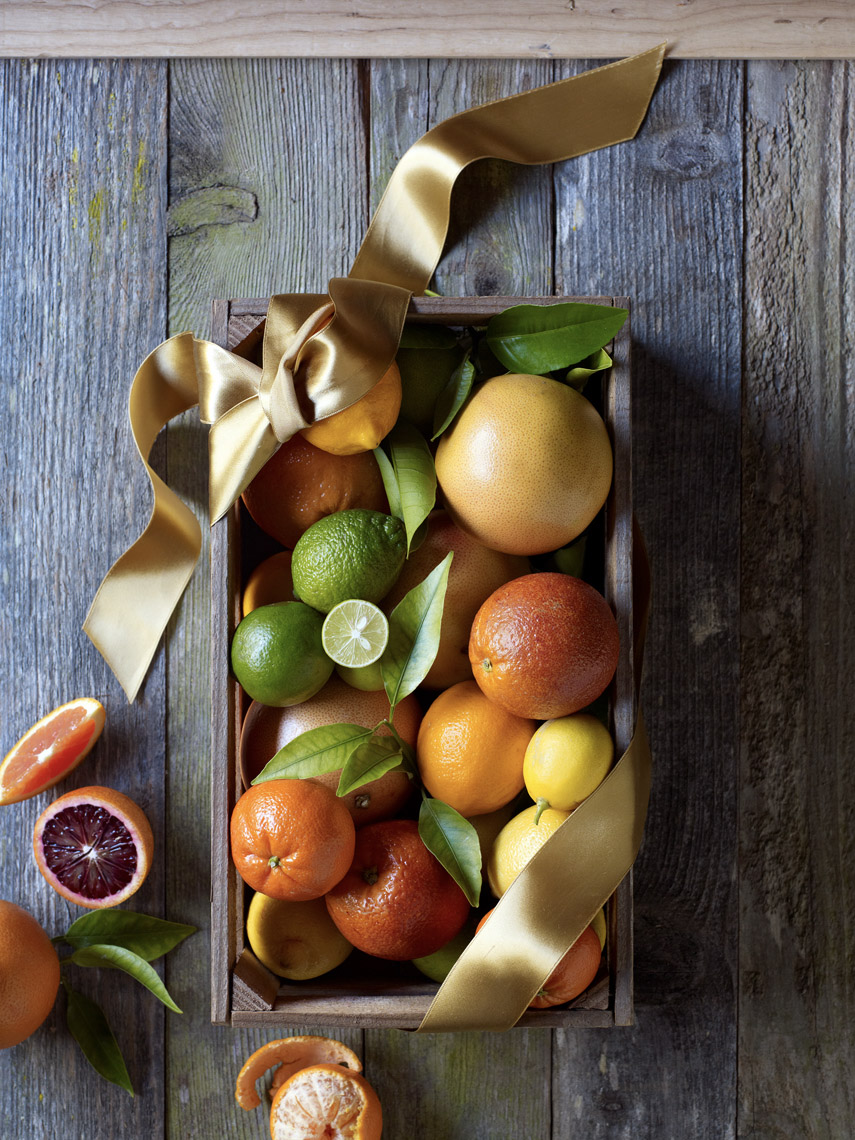 food stylist in San Francisco - Citrus in a crate - Grapefruits, bloodoranges, oranges, clementines, lemons, limes Sunset Magazine cover January photographed by Aya Bracket photographer