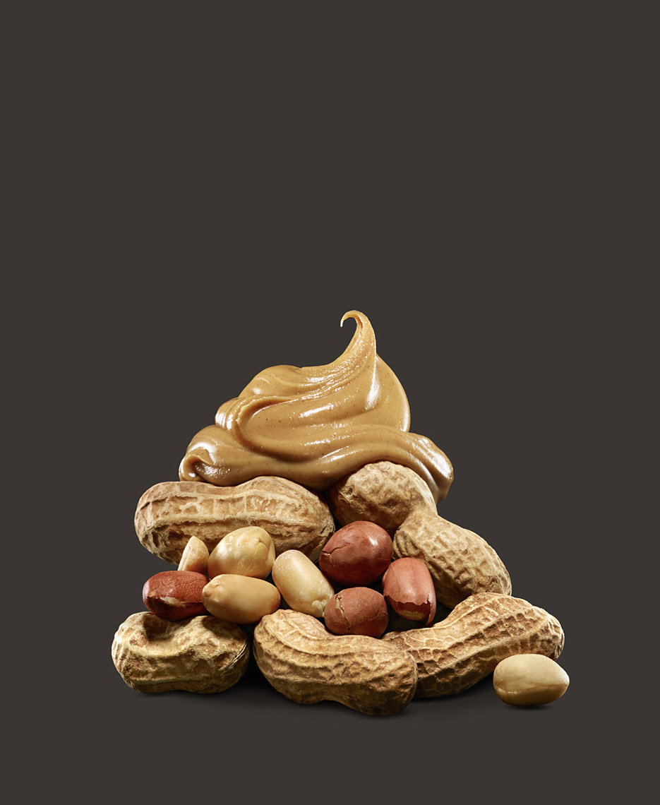 food stylist in San Francisco - Peanuts in shells stacket with peanut butter MetRX bar - Advertising photographed by Maren Caruso photographer