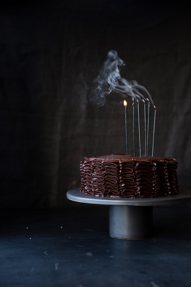 food stylist in San Francisco - Chocolate birthday layer cake with candles Let us All eat Cake cookbook - Catherine Ruehle author photographed by Erin Kunkel Photographer