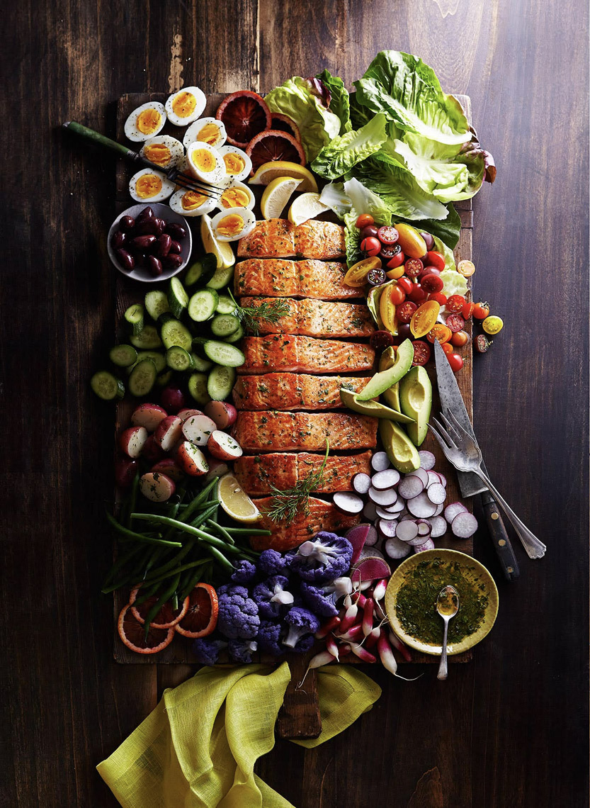Robyn Valarik San Francisco Based Food & Drink Stylist - Salmon, platter, brunch, colorful, vegetables, garnish, cauliflower, asparagus, lemons, herbs, avocado, tomatoes, coho, Atlantic, broccoli, lunch, gathering, spread, spring, summer, cutting-board, tabletop, food-photography