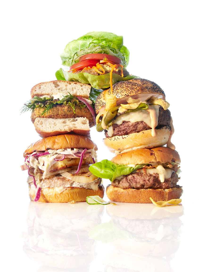 food stylist in San Francisco - Burger wall: Fish burger, chicken burger, hamburger, and veggie burger, photographed by Annabelle Breakey photographer